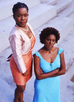 Ava Dusoleil (Debra Boucaud Mason, left) with Kenya Dusoleil (Alicia Allahar, rigt) Photographer: Alex Smailes