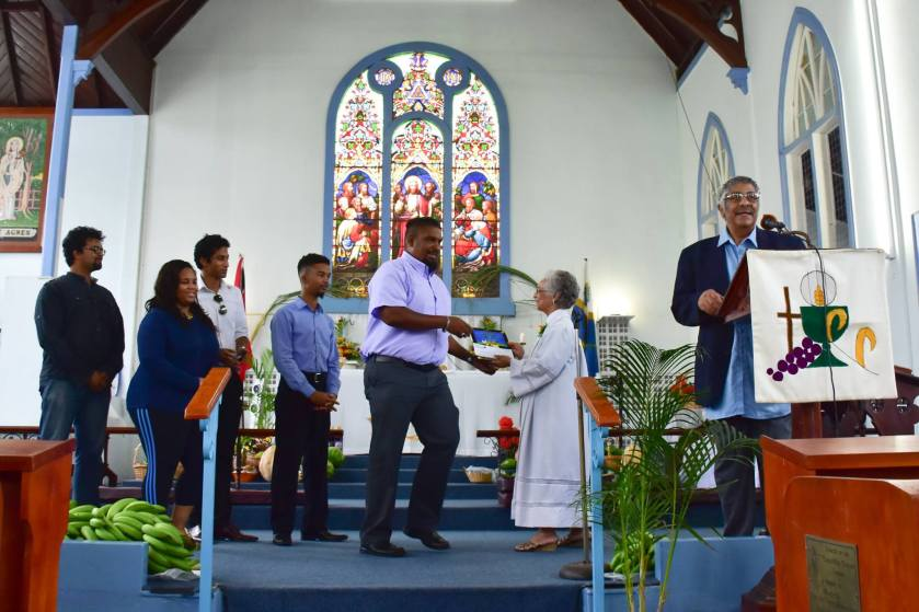 JCS Entertainment makes a presentation to St. Agnes Anglican Church