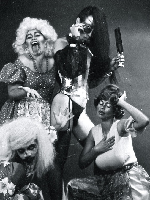 "Promotional still for Richard O'Brien's The Rocky Horror Show, with Godfrey Sealy as ""Riff Raff"", Simone Hamel-Smith as ""Magenta"", Mervyn de Goeas as ""Frank N. Furter"" and Suzanne Wallace as ""Magenta"". This production marked Mervyn's Directorial Debut (The Astor Theatre, Trinidad, 1984) 