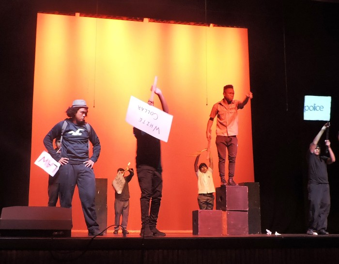 An inspired bit of choreography with protest signs and black outfits showcased the work and dedication the students must have poured into the play | Photo credit: Tracy Tuitt