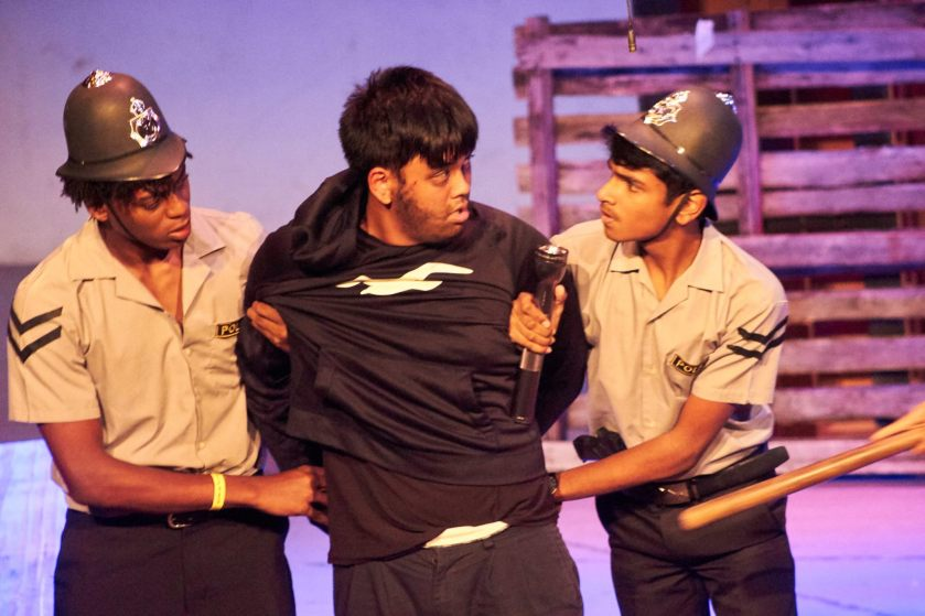 Emmanuel Williams (left), Justin Lee (center) and Joshua Dowlath (right) in 'The Inspector' for the 10th Biennial Caribbean Secondary Schools' Drama Festival | Photo Courtesy: The Cultural Development Division – Antigua and Barbuda
