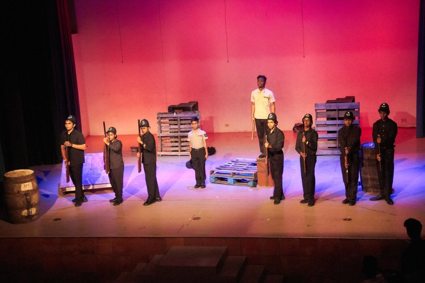 """Side by Side we stand"". 'The Inspector' for the 10th Biennial Caribbean Secondary Schools' Drama Festival 